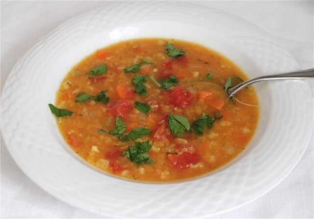 Easy Lentil Vegetable Soup - so easy to make and it makes a lot that freezes well. Lots of add-in options too