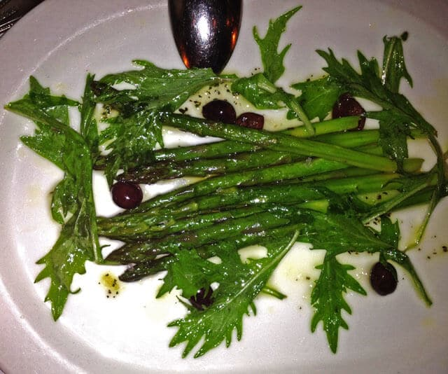 Warm Asparagus Provencal with Garlic, Olive Oil, Rosemary, and Black Olives at Lark Restaurant