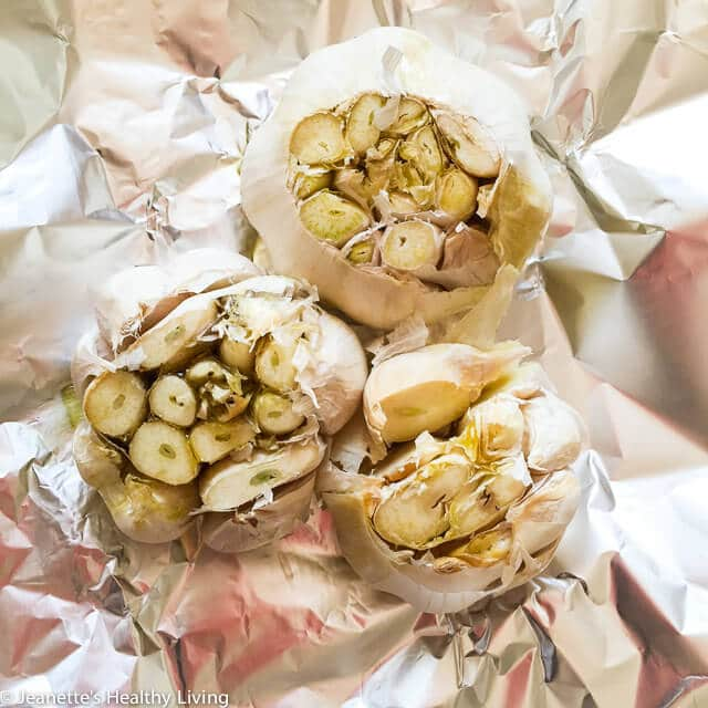 Learn how to roast garlic. It's easy to make and serves as a flavor booster in dips, sauces, soups, mashed potatoes and more ~ http://jeanetteshealthyliving.com