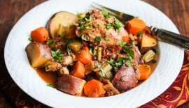 Slow Cooker Chicken Vegetable Stew - This stew will warm your belly and make your kitchen smell amazing! Braised in a tomato-based sauce and flavored with rosemary, thyme and sage, it's pure comfort food.