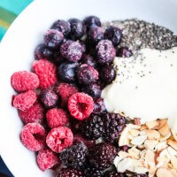 Triple Berry Oatmeal Smoothie Bowl with Almonds and Chia Seeds - the perfect healthy breakfast packed with protein, fiber and antioxidants