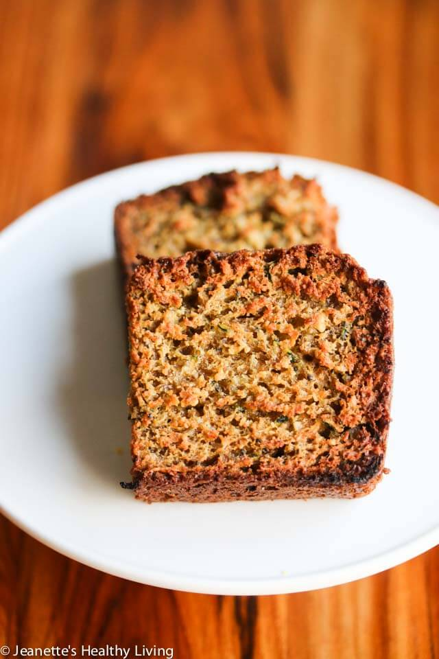 Gluten Free Lemon Zucchini Bread - this lemon scented quick bread makes a healthy snack or breakfast bread. Made with almond flour, oat flour and flax seeds, it's nutritious and delicious.