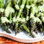 Grilled Asparagus with Mint Feta Pesto - a delicious and easy way to dress up asparagus this summer