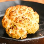 Roasted Whole Cauliflower with Pistachio Herb Sauce - this is so easy and makes a beautiful presentation at the table