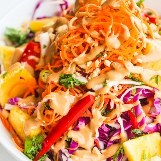 Asian Slaw with Spicy Peanut Salad Dressing - this healthy salad is full of crunch and the spicy peanut salad dressing adds a punch of flavor!