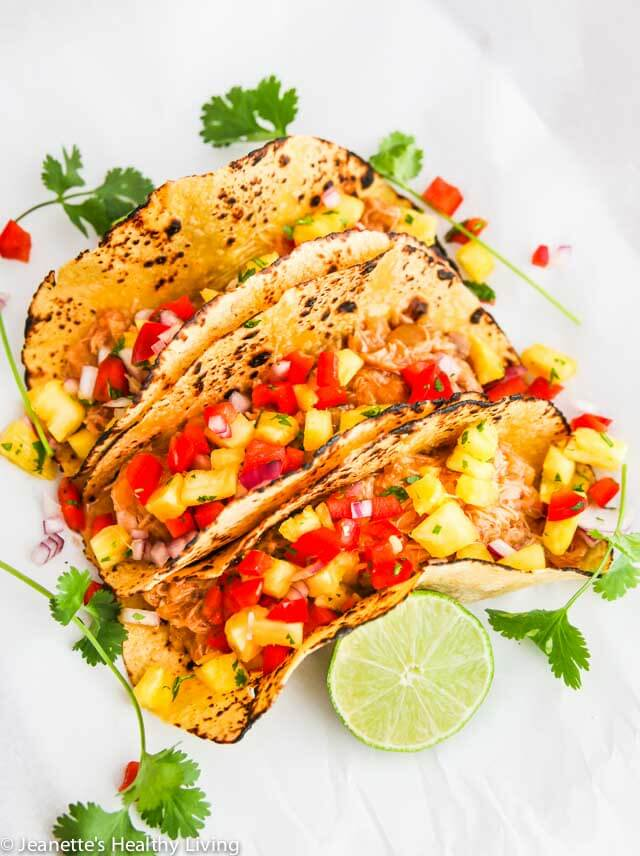 Crockpot Shredded Hawaiian Chicken Tacos - the filling for these tacos is sweet and tangy. Versatile too - can also be served in a rice bowl or on a bun with some slaw ~ http://jeanetteshealthyliving.com