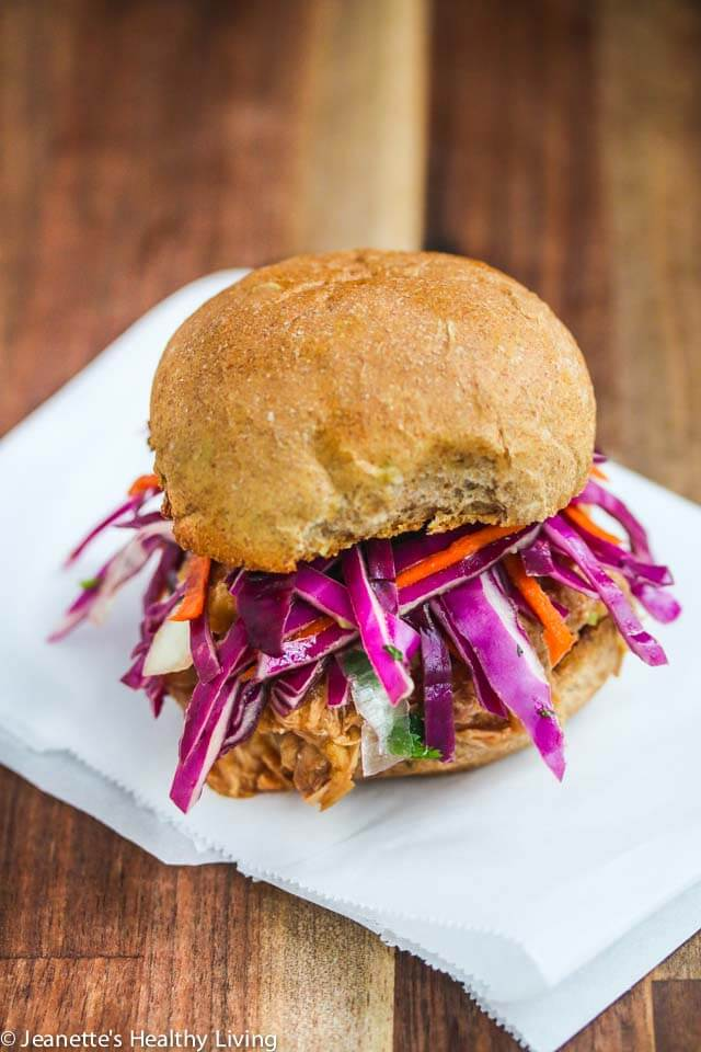 Crockpot Shredded Hawaiian Chicken on a bun with slaw - this chicken filling is sweet and tangy. Versatile too - can also be served as taco filling or in a rice bowl ~ http://jeanetteshealthyliving.com