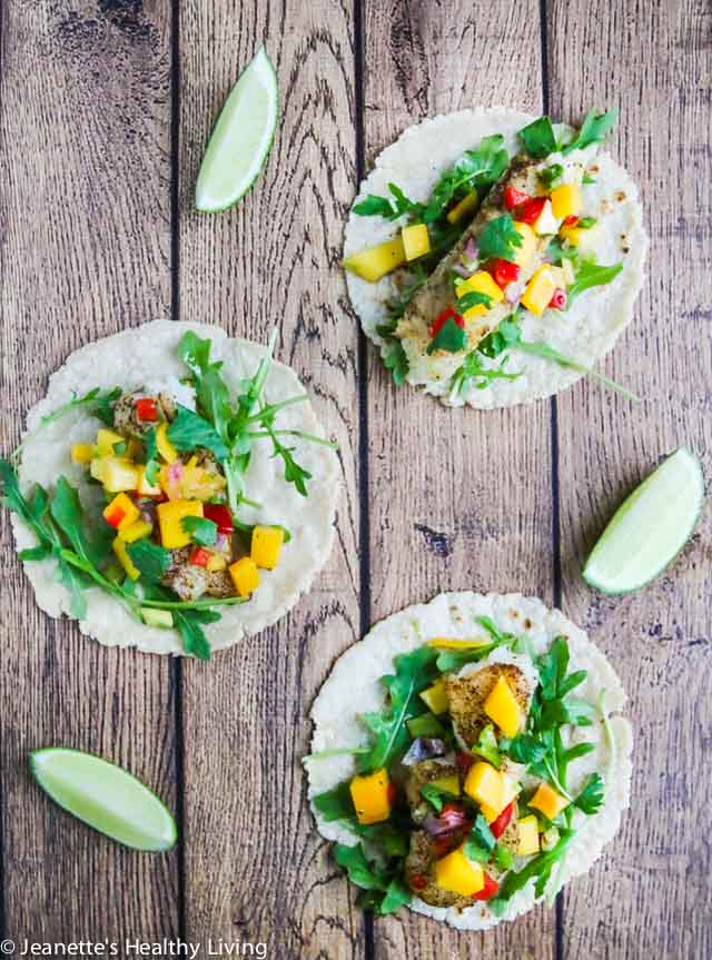 Pan Roasted Cod Fish Tacos - quick and easy to cook, this is a delicious, light and healthy fish taco. Delicious served with fresh mango salsa on top.