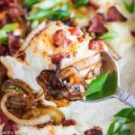 Loaded Mashed Cauliflower Casserole with Bacon and Caramelized Onions - so rich and creamy, no one will guess cauliflower is the star