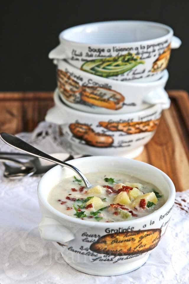 Skinny New England Cauliflower Clam Chowder - this low carb version of a favorite soup is a winner! No one will guess that cauliflower is the secret ingredient