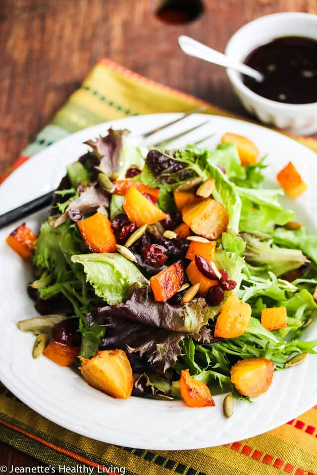 Roasted Butternut Squash Beet Cranberry Salad - you'll love the rich dressing made with apple cider, pumpkin seed oil and honey. Great salad for the holidays!