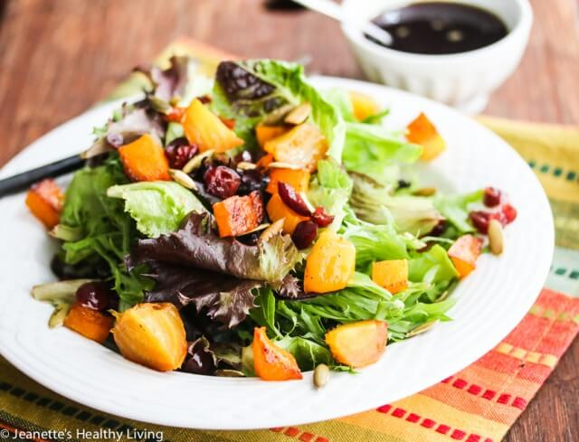 Roasted Butternut Squash Beet Cranberry Salad - you'll love the rich dressing made with apple cider, pumpkin seed oil and pomegranate balsamic vinegar. Great salad for the holidays!