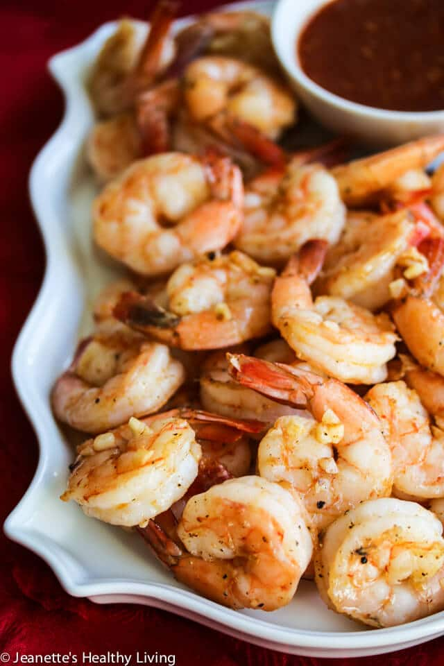 Roasted Shrimp Cocktail- Roasting the Shrimp + Fresh Garlic + Spanish Smoked Paprika take this Shrimp Cocktail to a whole new level - I just made these for a big gathering and they were a huge hit! https://jeanetteshealthyliving.com