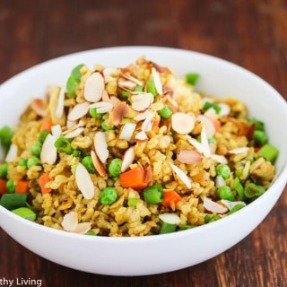 Chicken Curry Fried Rice - a quick, easy and healthy one-pan dinner made with leftover cooked chicken, brown rice, carrots and peas. Toasted almonds make a nice crunchy topping.