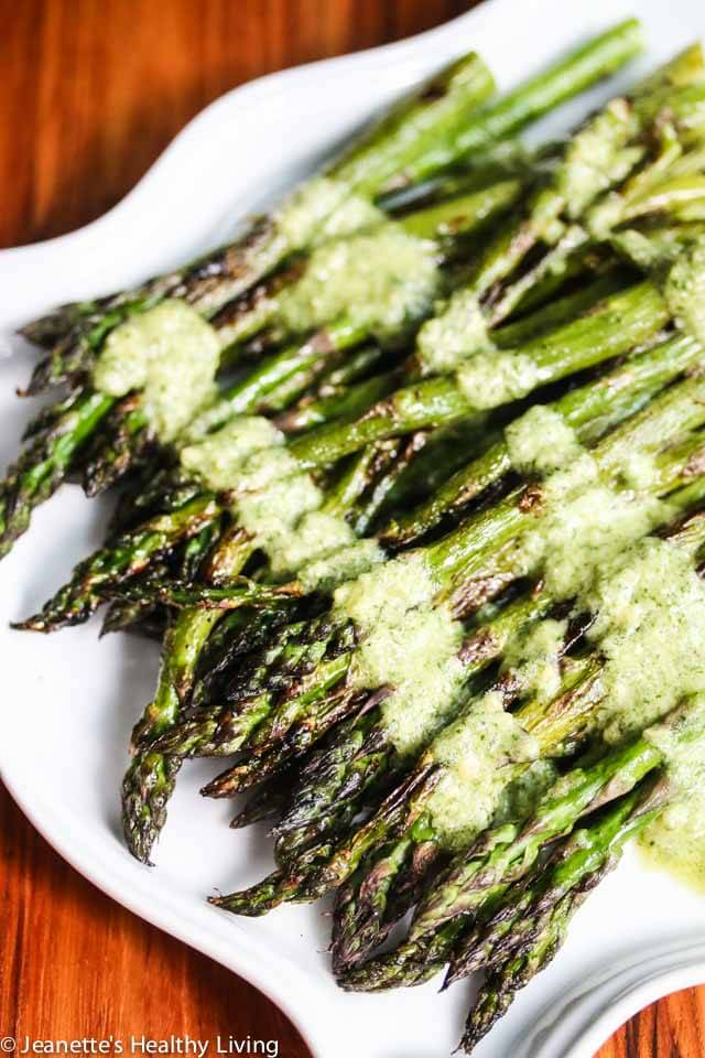 Grilled Asparagus with Mint Feta Pesto - the fresh tangy mint feta topping brings grilled asparagus up a notch. Delicious and easy to make, great for entertaining this summer