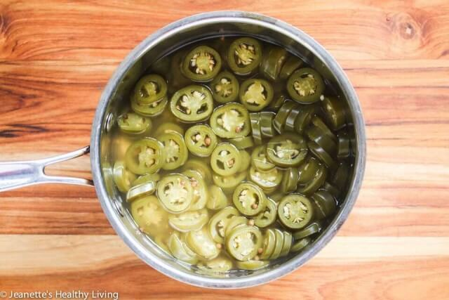 Pickled Jalapeño Peppers - so easy to make at home. Garlic and coriander seeds add a little something special.