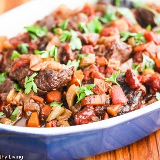 Slow Cooker Red Wine Beef Shank Stew - delicious over rice, pasta or mashed potatoes. Leftovers are terrific topped with mashed potatoes and baked, or made into beef vegetable soup (add leftover cooked whole grains or pasta)