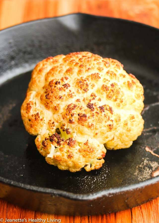 Roasted Whole Cauliflower with Pistachio Herb Sauce - this is so easy to make; you can present the whole roasted cauliflower and break it up at the table