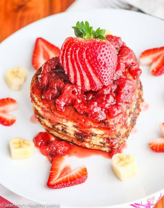 Whole Wheat Buttermilk Banana Chocolate Chip Pancakes with fresh Strawberry Sauce - treat your loved ones to a gorgeous stack of these pancakes for Valentine's Day or any other special occasion!
