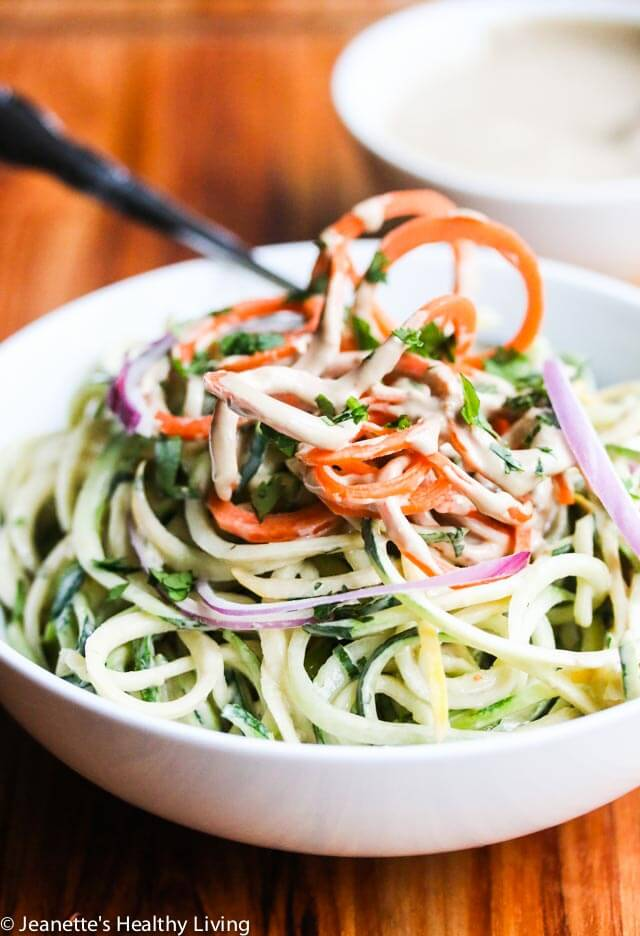 Zucchini Noodles with Sunflower Seed Butter Dressing - this dressing is SO delicious! Made with sunflower seed butter and coconut milk, it is rich and creamy.