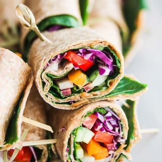 Rainbow Vegetable Wraps with Peanut Sauce - these portable sandwiches are perfect for lunch or an afternoon snack - full of veggies and a delicious peanut sauce