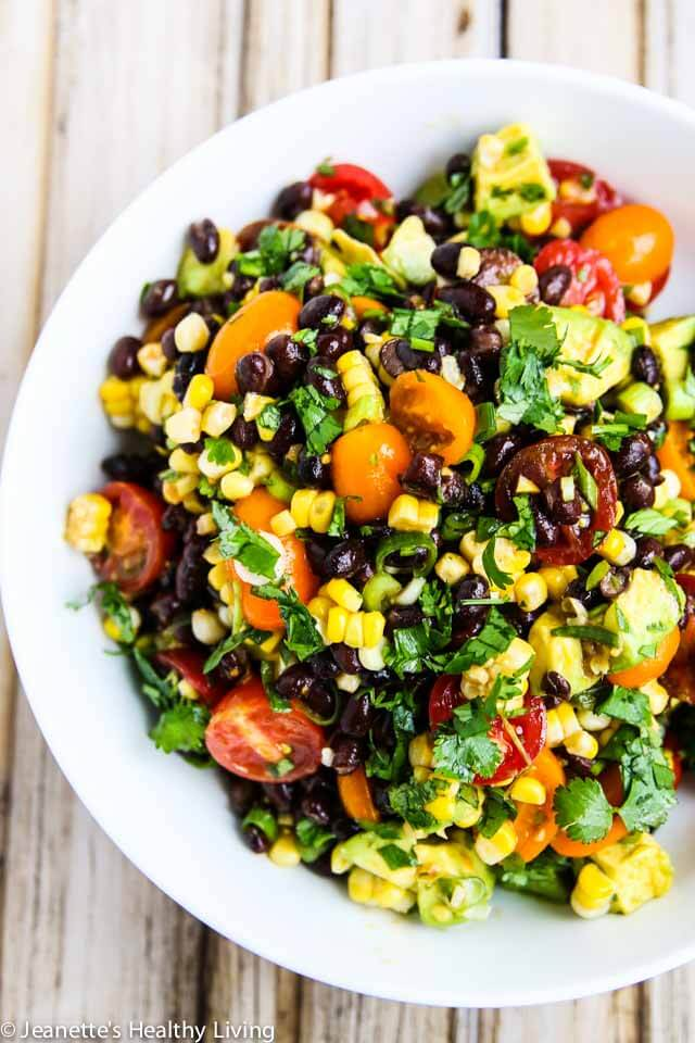 Chipotle Black Bean Corn Tomato Avocado Salad - this can be eaten as a dip or a salad - perfect for summer barbecues and picnics!