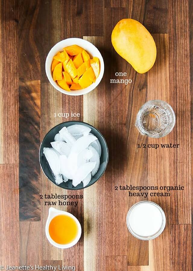 Mango Batido - a refreshing tropical drink that is so easy to make! Perfect for poolside or pretending you're at the beach.