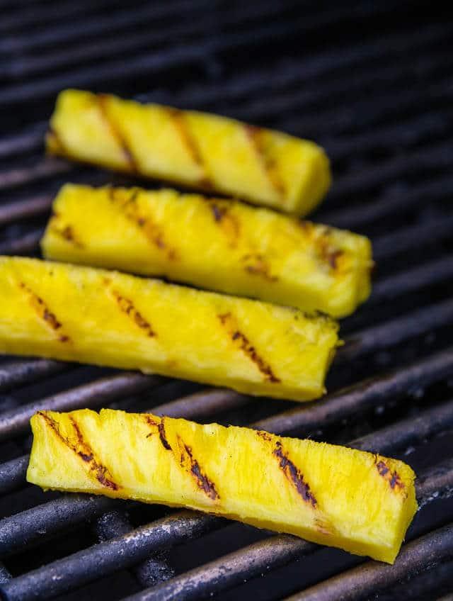 Grilled Pineapple Spllit Sundae - this tropical sundae features sweet grilled pineapple and a honey cinnamon nutmeg ice cream sauce ~ https://jeanetteshealthyliving.com