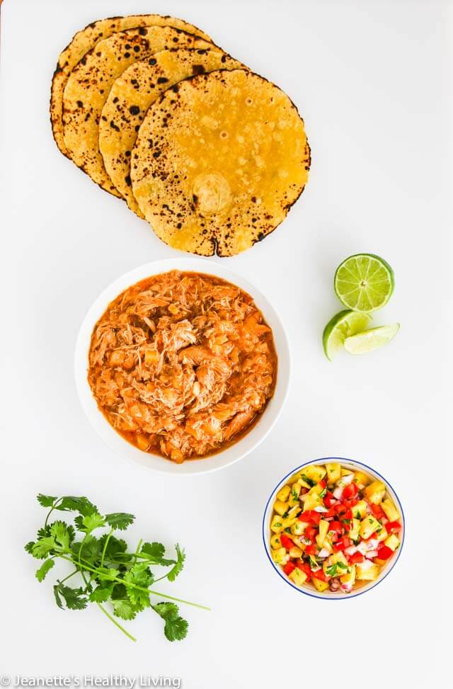 Crockpot Shredded Hawaiian Chicken Tacos - the filling for these tacos is sweet and tangy. Versatile too - can also be served in a rice bowl or on a bun with some slaw ~ https://jeanetteshealthyliving.com