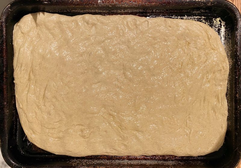 focaccia pressed into sheet pan