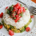 Crabmeat Avocado Tomato Basil Appetizer with Wasabi Soy Dressing - impress your guests with this beautiful presentation. The wasabi soy dressing spices things up a bit