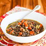 Slow Cooker Lentil Smoked Ham Soup - made with mineral rich chicken bone broth and a smoky ham bone, this simple lentil soup is rich and flavorful